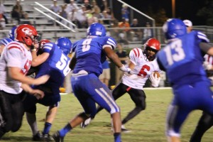 Freshman Alontae Taylor makes a cut to gain yardage against BGA on Friday night. He led the Raiders with 77 yards rushing.