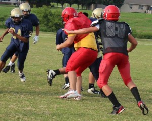 CCMS middle linebacker Clayton Lowell (in black jersey) fills the hole in a recent scrimmage versus Rock Springs