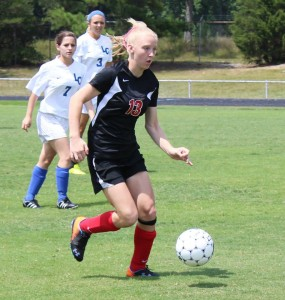 Eliza Masters works the ball for Coffee County High School.. Photo by Dennis Weaver