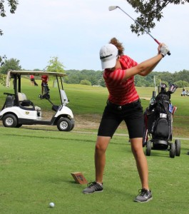 Hollee Sadler tees off in a match earlier this season.. Photo by Dennis Weaver