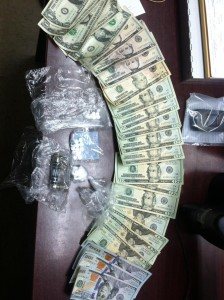 Drugs, money and more found during arrest.