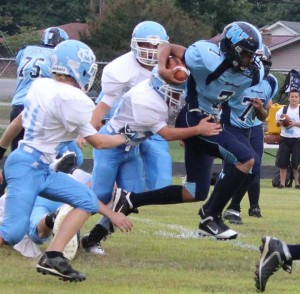 Marcus Pendleton(#7) breaks through the arm tackles of the Moore County defense in a game from earlier in the season.. Story and photo by Dennis Weaver