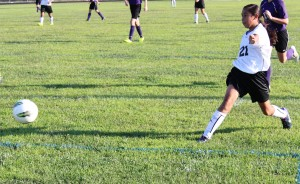 Westwood's Reyna Flores(#21) drills a goal past the Community keeper on THursday night in middle school soccer action.
