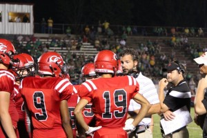 Coach Ryan Sulkowski talks to his team on Friday night