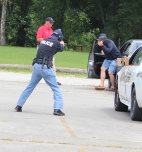"""A STOPS candidate (foreground) gets into a """"firefight"""" with the """"bad guy"""" under the supervision of the STOPS instructor (background).. Photo and story by Dennis Weaver"""