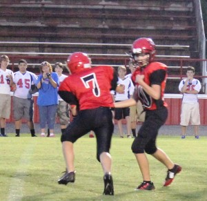 Hayden Skipper(#7) takes the hand off from Raider QB Bryson Hullett (#10) during teh CCMS JV football game on Monday night