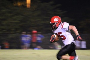 Cody Howes takes a kickoff 93 yards for a TD.. Photos by Barry West