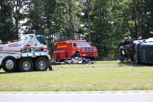 Emergency crews on the scene of tractor-trailer accident.