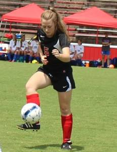 Alex Ellison plays the ball forward for Coffee County in a recent soccer match... Photo by Dennis Weaver