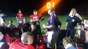Coffee County Middle School head coach Brock Freeze talks to his team following their 18 to 6 win over North Franklin on Tuesday night