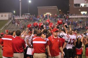 Let the celebration begin. Coach Ryan Sulkowski won his first game as the Raider head coach. The team, coaches and fans celebrated after the OT win in McMinnville... Photo by Barry West