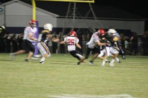 Cody #25 makes a cut to score a TD on Friday night... Photo by Barry West
