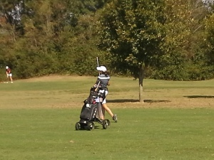 Hollee Sadler hits her approach shot at #5 during the state tournament on Tuesday. Sadler has played in 3 consecutive state tournaments.