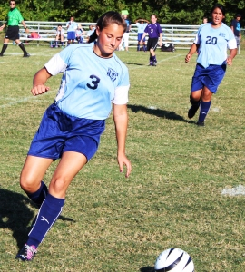 Westwod soccer midfielder Natalie Elzeer (#3) prepares to send a ball forward as Naylei Ramirez (#20) moves with the play in the background
