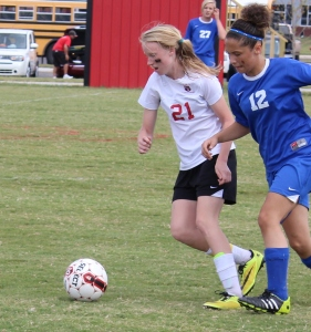Jenna Garretson (#21) battles for possession in a recent match.. Photo by Dennis Weaver