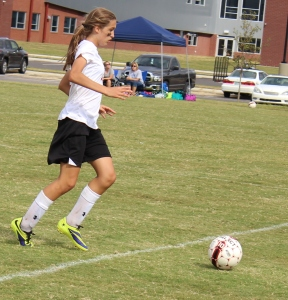 Julia Duncan dribbles the ball for the Lady Raiders.