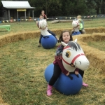 Lucky and Mary Knott's daughter Keesha having fun on the farm