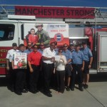Manchester Fire & Rescue hands over check to Holly Carroll of MDA.