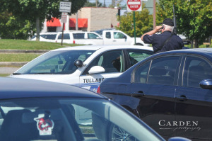 Tullahoma PD officer with his rifle pointed up at ready talking on phone outside THS during the lockdown. Tullahoma Police on the scene during Thursday's lockdown.. Please credit Norris Carden - Carden Photography.