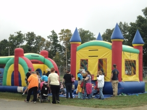 Children had fun in the bounce houses... Photo by Samantha Watters