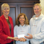 Highland Rim Bicycle Club members Tim and Julia Harrison present a donation for the Motlow College Foundation to Jan Rogers, director of advancement at Motlow. The donation results from proceeds the Club received during its recent Elk River Valley 100 bicycle ride... Motlow photo.