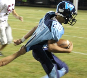 Westwood halfback Leo Botello(#20) fights for extra yardage against Eagleville in Thursday's 30 to 22 home loss.