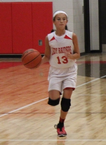 Coffee County Middle School 6th grade basketball player Bella Vinson brings the ball up the floor.