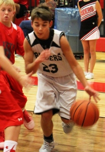 Coffee County Middle School basketball player Kyle Farless drives to the basket.