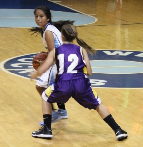 Westwood's Karen Medina looks to pass the ball against a Community defender... Photos by Dennis Weaver