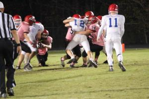 #34 Reese Pratt makes a tackle on a Falcon runner.