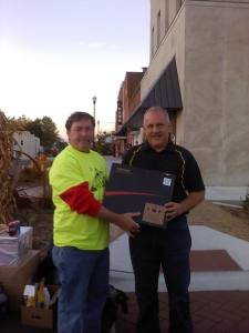 Travis Milligan winner of the laptop with Roger Steele of the Old Timers Day committee.