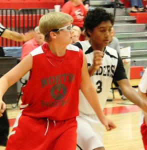 CCMS post player Trevor Horne (Right) battles for position after a free throw in a recent game with North... Photos by Dennis Weaver