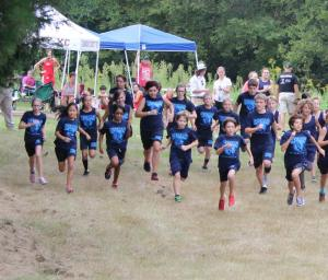 Westwood's Cross Country team leaves the starting line in a recent match
