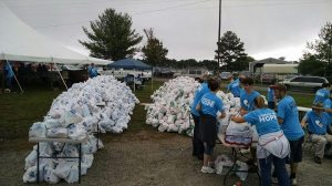 Volunteers preparing to hand out tons of free food... Photo by Tiffany Clutter