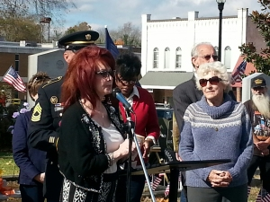 Naomi Judd speaking at the ceremony last Tuesday on the square in Manchester.