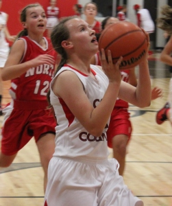CCMS Lady Raider Abby Morgan goes up for a shot against North Franklin... Photos by Dennis Weaver