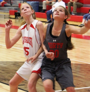 CMS 6th grade basketball player Amelia Prater(white #15) battles for position with a North Franklin player(gray) earlier this season... Photos by Dennis Weaver