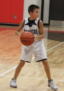 Hayden Hullett looks to pass the ball in for Coffee County Middle School's 6th grade basketball team.