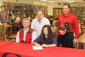 Hollee sitting with her Mom and Dad. Coach Mike Ray (left) and Willowbrook's Barry Bishop... Photo by Barry West