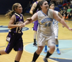 Haley Miller works hard for the Lady Rockets... Photo by Dennis Weaver