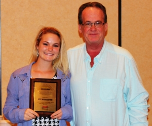 Izzy Huddleston (left) with Manager Jeff Cox of Gateway Tire and Service Center... Photo by Dennis Weaver