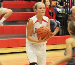CCMS 6th grader Kylie Phillips looks to pass the ball in recent game action... Photos by Dennis Weaver