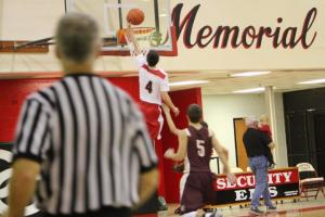 Wyatt Day goes high for 2 of his 19 against Cannon County.