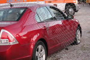 Car crashes through a fence... Photo by Barry West