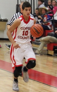 CCMS basketball player Andrew Mahaffey brings the ball up the floor