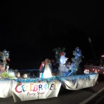 Our Christmas float makes its way through the parade route.