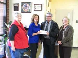 Photo ID L-R: Janet Nettles, broker of Middle Tennessee Properties; Golf Scramble Chairperson Vicky Spellings, broker of Exit Realty Partners; Sheriff Steve Graves and Sandy McKinney of the Coffee County Sheriff's Department.
