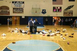 The floor of the Joel Vinson Gym filled with many of the stuffed animals donated as part of the 2014 Teddy Bear Toss - Photo by Rob Clutter