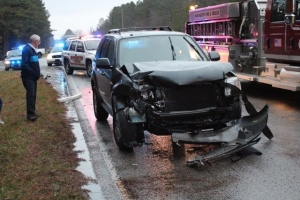 Bryan SUV heavily damaged in Monday's crash... Photos by Barry West