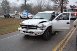 SUV damaged during the crash. Driver taken to an area hospital.